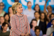 Hillary Clinton, presumptive 2016 Democratic presidential nominee, listens as Senator Tim Kaine (D-VA) introduces her at Northern Virginia Community College in Annandale, Va., U.S., on Thursday, July 14, 2016. Clinton and the former Virginia Governor discussed their shared commitment to building an America that is stronger together, while emphasizing that Donald Trump's divisive agenda would be dangerous for America. Kaine is considered to be the frontrunner for the Vice Presidential slot. Photographer: Pete Marovich/Bloomberg