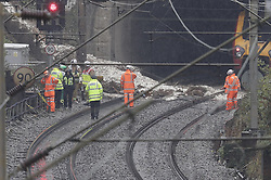 © Licensed to London News Pictures. 16/09/2016. Watford, UK. Network Rail and other emergency workers stand by andslide that has derailed a train near Watford, following heavy rainfall over night. A train is stuck in the tunnel. Photo credit: Peter Macdiarmid/LNP