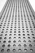 The 52 story Jardine House building, located in the Central district of Hong Kong, was completed in 1973. It was built on reclaimed land and the design was by Palmer and Turner, now the P&T Group. This image is part of a personal photo project which features images that highlight geometrical patterns in architecture.