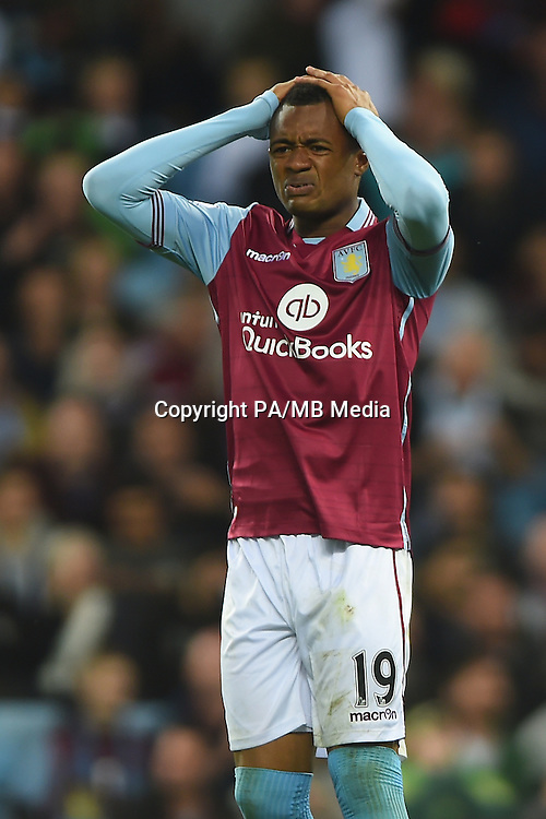 Aston Villa's Jordan Ayew stands dejected