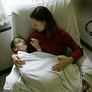 ANNABELLE -- detroit, nov. 7 -- Gina Costanzo holds her daughter Annabelle about 30 minutes after the 7 year-old underwent eye surgery Friday morning at Beumont Hospital in Detroit in 2004.  Annabelle's doctor, Michael Trese, performed a procedure called pupil plasty, which created an opening in the pupil where there had been a membrane.  photo by david peterson
