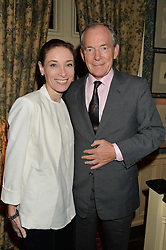 SIMON JENKINS and HANNAH KAYE at a party to celebrate the publication of Right or Wrong: The Memoirs of Lord Bell held at Mark's Club, Charles Street, London on 16th October 2014.