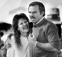 File photo - Actor Burt Reynolds jokes with Monica Haury of Palm Beach Gardens after she asked if she could have a kiss before the taping of Win, Lose or Draw on Jan. 28, 1989. 1970s' movie heartthrob and Oscar nominee Burt Reynolds has died at the age of 82. He reportedly passed away in a Florida hospital from a heart attack with his family by his side. Photo by Sean Dougherty/Sun Sentinel/TNS/ABACAPRESS.COM