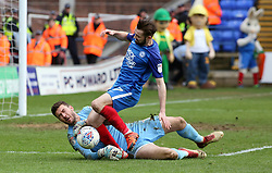 Gwion Edwards of Peterborough United challenges for the ball with Richard O'Donnell of Northampton Town - Mandatory by-line: Joe Dent/JMP - 02/04/2018 - FOOTBALL - ABAX Stadium - Peterborough, England - Peterborough United v Northampton Town - Sky Bet League One