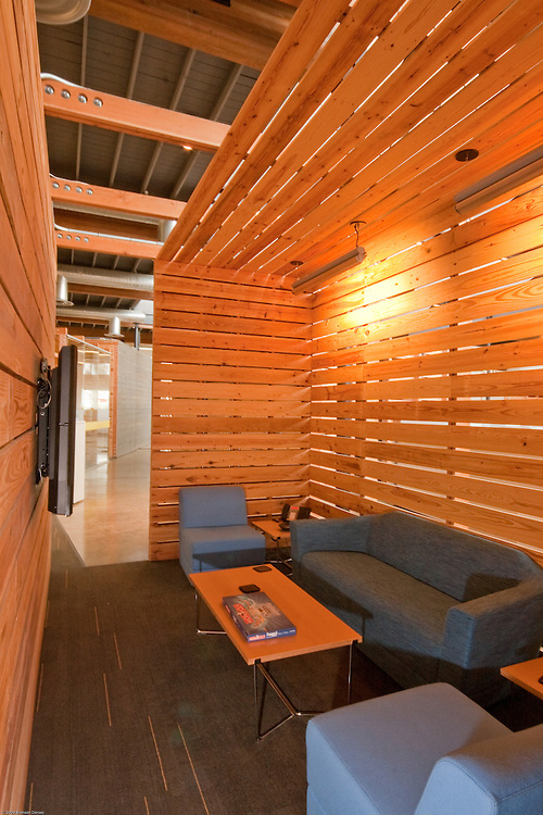 Slatted walls provide enclosure and semi-privacy for seating area at Lance Armstrong Foundation offices.