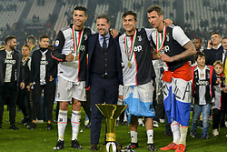 May 19, 2019 - Turin, Turin, Italy - Cristiano Ronaldo, Fabio Paratici, Paulo Dybala, Mario Mandzukic of Juventus FC celebrate the trophy of Scudetto  2018-2019 at Allianz Stadium, Turin  (Credit Image: © Antonio Polia/Pacific Press via ZUMA Wire)