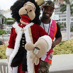 Jun 19, 2012; Miami, FL, USA; Miami Heat fan Kareem Fletcher performs with a puppet outside of American Airlines Arena before game four in the 2012 NBA Finals against the Oklahoma City Thunder. Mandatory Credit: Derick E. Hingle-US PRESSWIRE