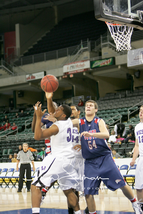 Jaguar forward Devonte Majors (3) and Patriot forward Tommy Holaway (54) battle for a rebound.