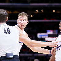 08 December 2014: Los Angeles Clippers forward Blake Griffin (32) reacts in front of referee Ben Taylor (46) next to Los Angeles Clippers guard Chris Paul (3) during the Los Angeles Clippers 121-120 overtime victory over the Phoenix Suns, at the Staples Center, Los Angeles, California, USA.