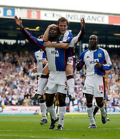 Photo. Jed Wee<br /> Blackburn Rovers v Wolverhampton Wanderers, FA Barclaycard Premiership, Ewood Park, Blackburn. 16/08/2003.<br /> Blackburn's David Thompson goes for a ride on goalscorer Andy Cole's shoulders as Dwight Yorke (R) also looks to join in the celebrations.