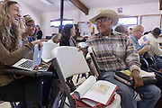 Navajo community leader Daniel Tso talks with Rebecca Sobel of Wild Earth Guardians before the start of a meeting at the chapter house in Counselor New Mexico where the Bureau of Land Management was hearing public comments on proposed new sites for leasing rights to additional drilling in the San Juan Basin.