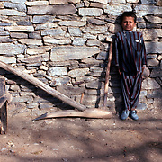 2-4 December 1976<br /> Boy standing by tip in front of clearly detailed stone wall.