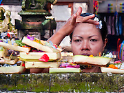 Apr. 25 -- UBUD, BALI, INDONESIA:  A woman prays and makes an offering in the tourist market in Ubud. Ubud is considered Bali's artistic and cultural heart. About 20 miles from the beaches near Kuta, it attracts a slightly older crowd.  PHOTO BY JACK KURTZ