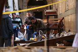 CAIRO, Dec. 11, 2016 (Xinhua) -- Egyptian policemen inspect the explosion site in Cairo, Egypt on Dec. 11, 2016. At least 25 people were killed and 49 others injured on Sunday in an explosion at the Coptic Cathedral in Abbasiya's neighborhood of Cairo, Egypt's Ministry of Health said in a statement. (Xinhua/Ahmed Gomaa) (lrz) (Credit Image: © Ahmed Gomaa/Xinhua via ZUMA Wire)