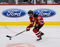 Nov 1, 2008; Newark, NJ, USA; New Jersey Devils right wing Jamie Langenbrunner (15) skates with the puck during the third period at the Prudential Center. The Devils defeated the Thrashers 6-1.