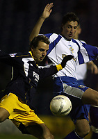 Photo: Paul Thomas.<br /> Bury v Weymouth. The FA Cup. 21/11/2006.<br /> <br /> Weymouth's Wayne Purser (L) fights off John Fitzgerald.