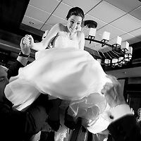 Jillian is hoisted during the hora at her wedding to Josh at the Nita Lake Lodge in Whistler, British Columbia.