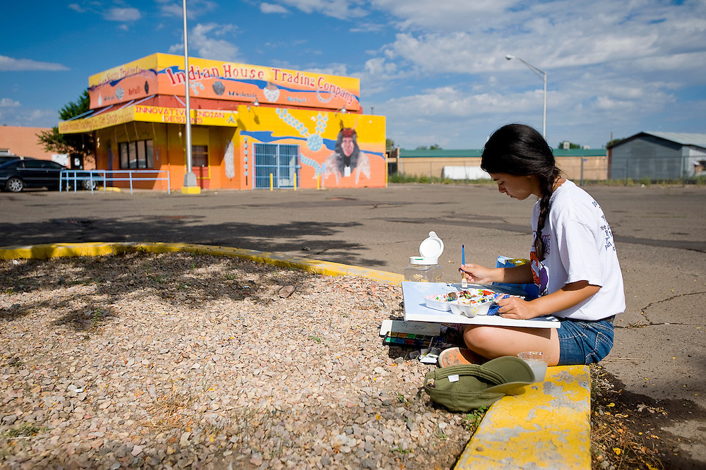 081111       Brian Leddy.Claire Iralu, 15, paints a downtown Gallup scene on Thursday morning. The young artist is preparing for her first show during the September Arts Crawl at Crashing Thunder Gallery.