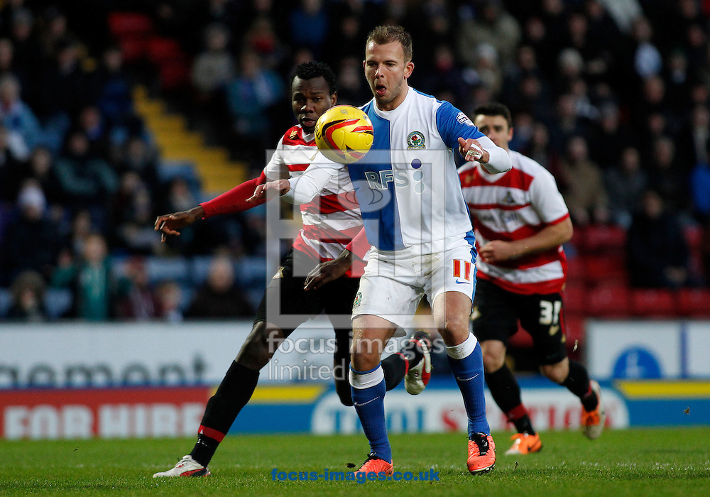 Picture by Michael Sedgwick/Focus Images Ltd +44 7900 363072<br /> 11/01/2014<br /> Jordan Rhodes of Blackburn Rovers and Bongani Khumalo of Doncaster Rovers in action during the Sky Bet Championship match at Ewood Park, Blackburn.