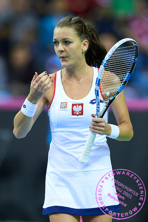 Agnieszka Radwanska from Poland during Second Day of the Fed Cup / World Group 1st round tennis match between Poland and Russia at Tauron Krakow Arena on February 8, 2015 in Cracow, Poland.<br /> <br /> Poland, Cracow, February 8, 2015<br /> <br /> Picture also available in RAW (NEF) or TIFF format on special request.<br /> <br /> For editorial use only. Any commercial or promotional use requires permission.<br /> <br /> Adam Nurkiewicz declares that he has no rights to the image of people at the photographs of his authorship.<br /> <br /> Mandatory credit:<br /> Photo by &copy; Adam Nurkiewicz / Mediasport