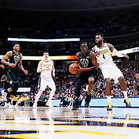 01 April 2018: Milwaukee Bucks guard Tony Snell (21) drives past Denver Nuggets forward Paul Millsap (4) during the Denver Nuggets 128-125 victory over the Milwaukee Bucks, at the Pepsi Center, Denver, Colorado, USA.