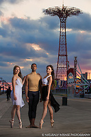 Ballerinas and dancers on Coney Island Boardwalk, Brooklyn, New York. Dance as Art featuring Anna Polyachenko, Julian Watson and Sabrina Imura