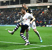 David Wheater and Joe Garner battle  during the Sky Bet Championship match between Preston North End and Bolton Wanderers at Deepdale, Preston, England on 31 October 2015. Photo by Pete Burns.