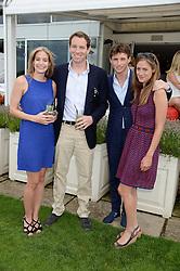 Left to right, EMMA REDMAYNE, JAMES REDMAYNE, EDDIE REDMAYNE and HANNAH BAGSHAWE at the Audi International Polo at Guards Polo Windsor Great Park, Egham, Surrey on 28th July 2013.
