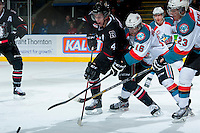 KELOWNA, CANADA -FEBRUARY 5: Haydn Fleury D #4 of the Red Deer Rebels is back checked by Kris Schmidli #16 of the Kelowna Rockets on February 5, 2014 at Prospera Place in Kelowna, British Columbia, Canada.   (Photo by Marissa Baecker/Getty Images)  *** Local Caption *** Haydn Fleury; Kris Schmidli;