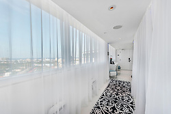 British singer Craig David has finally placed his legendary Miami party pad on the market for $5.75 after moving back to the UK. The stunning two-bedroom penthouse, which is adorned with dozens of images of semi-naked women, became famous in the Miami celeb scene for hosting legendary wild parties. However, the British singer has finally decided to put his hedonistic ways behind him and focus on his music back home in his motherland. The lavish crib, which is situated in the famous Mondrian hotel, boasts two bedrooms and two bathrooms across 1,895 square feet. Miles Goldstein Real Estate is listing the swanky rooftop apartment, which has stunning views of the Miami skyline. It comes with glistening white marble floors, Craig David's personal piano and a professional recording studio. The apartment also comes with a vast sprawling balcony fitted out with a special hi-tech lighting system, a BBQ area, loungers and a luxury hot tub overlooking Biscayne Bay. 10 Jul 2019 Pictured: Craig David's stunning Miami penthouse. Photo credit: Miles Goldstein Real Estate/MEGA TheMegaAgency.com +1 888 505 6342