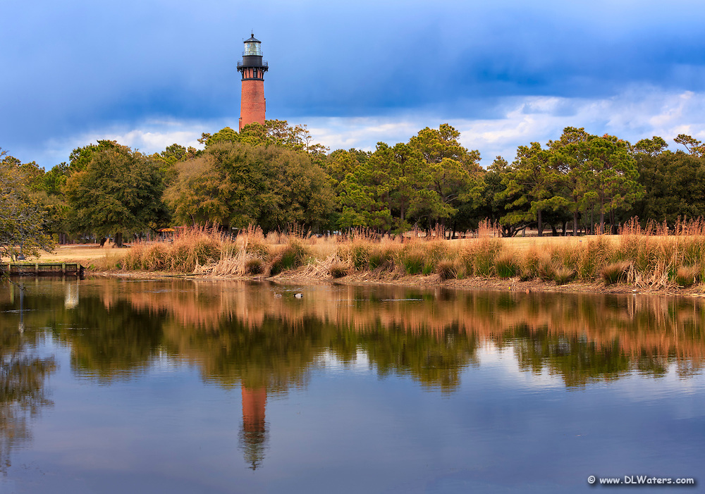 Reflection of the occurred to Beach lighthouse  in Corolla on a late afternoon.