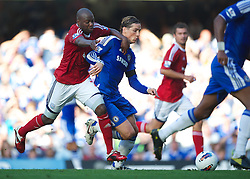 LONDON, ENGLAND - Saturday, August 20, 2011: Chelsea's Fernando Torres in action against West Bromwich Albion's Youssuf Mulumbu during the Premiership match at Stamford Bridge. (Pic by David Rawcliffe/Propaganda)