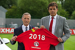 NEWPORT, WALES - Wednesday, August 7, 2013: Wales' Chris Coleman announces his squad and renewed Vauxhall sponsorship with Vauxhall's Keith Michaels during a press conference at Dragon Park FAW National Development Centre. (Pic by David Rawcliffe/Propaganda)