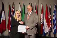 Eagle native Lauren Clark (left), an agribusiness major, receives an Oklahoma State University American Farmers & Ranchers Scholarship from Terry Detrick (right) at the university's recent College of Agricultural Sciences and Natural Resources Scholarships and Awards Banquet. The scholarship is part of more than $1.4 million in scholarships and awards presented to CASNR students for the 2016-2017 academic year. (Photo by Todd Johnson)