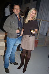 MISS EMMA GIBBS and ROB VAN HELDEN at an exhibition of work by Rolf Sachs - a unique world-renowned contemporary furniture designer, held in association with the Louisa Guinness Gallery and held at 250 Brompron Road, London on 6th October 2004.<br />