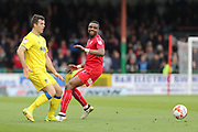 AFC Wimbledon striker Tom Elliott (9) and Swindon Town striker Jonathan Obika (9) during the EFL Sky Bet League 1 match between Swindon Town and AFC Wimbledon at the County Ground, Swindon, England on 14 April 2017. Photo by Stuart Butcher.