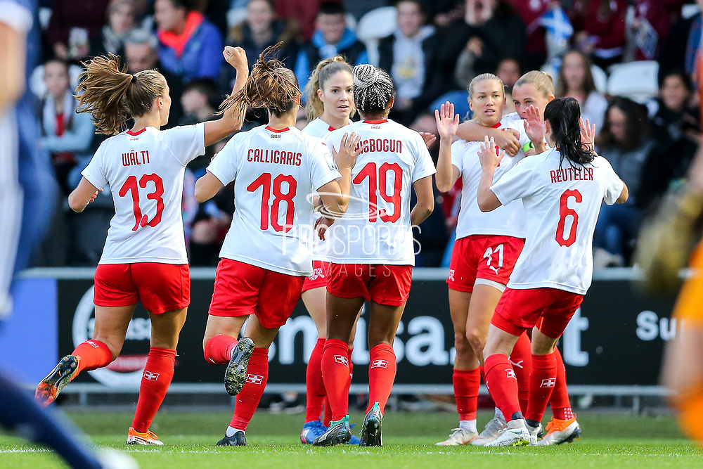 Switzerland players celebrate their first goal (2-1) scored by Lara Dickenmann (#11) of Switzerland during the 2019 FIFA Women's World Cup UEFA Qualifier match between Scotland Women and Switzerland at the Simple Digital Arena, St Mirren, Scotland on 30 August 2018.