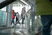passengers walking through a glass terminal
