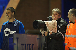 BIRKENHEAD, ENGLAND - Thursday, March 25, 2010: Wigan Athletic's club photographer Dave Kendall during the FA Premiership Reserves League (Northern Division) match at Prenton Park. (Photo by David Rawcliffe/Propaganda)