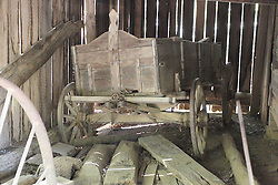08 October 2016:   Great Smokey Mountains National Park. an old grain wagon is store in a barn at Cades Cove Historic Area Visitors Center in Blount County Tennessee.  Cades Cove is within the Great Smoky Mountains National Park