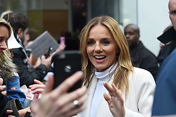 Spice Girls Geri Horner with fans outside Global Radio studios in Leicester Square, London.
