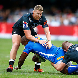 Jacques Vermeulen and Robert du Preez of the Cell C Sharks look to tackle Bongi Mbonambi of the DHL Stormers during the Super Rugby match between Cell C Sharks and DHL Stormers at Jonsson Kings Park on March 02, 2019 in Durban, South Africa. (Photo by Steve Haag)