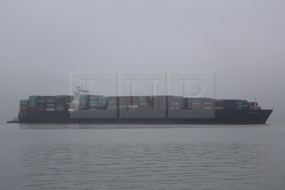 © Licensed to London News Pictures. 13/09/2013. The biggest container ship to ever grace the Thames arrived this afternoon in wet and misty conditions. Zim Rotterdam is a 349m long container ship, making it amongst the largest vessels to have ever been on the Thames. It was recently hit by a fire on board but the Israeli-owned vessel was turned away from the Suez Canal without explanation. Now, in its hour of need, the new London Gateway port had agreed to handle the containers. This unplanned visit is well ahead of when London Gateway expected to be first dealing with cargo and marks a landmark in its own right for the country's new deep water container port .  Credit : Rob Powell/LNP
