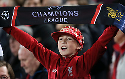 A Liverpool fan in the stands shows his support
