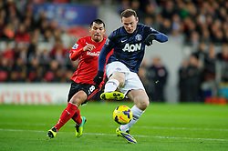 Man Utd Forward Wayne Rooney (ENG) controls the ball on the edge of the box before scoring during the first half of the match - Photo mandatory by-line: Rogan Thomson/JMP - Tel: Mobile: 07966 386802 - 24/11/2013 - SPORT - FOOTBALL - Cardiff City Stadium - Cardiff City v Manchester United - Barclays Premier League.