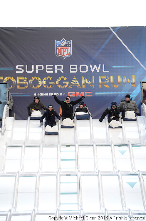 29 Jan 2014 NYC  Riders sliding down the Toboggan run on Superbowl boulevard in NYC on Broadway  Michael Glenn