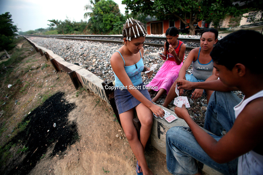 A card game is played alongside the railroad tracks in Aracataca on Sunday, January 28, 2007.  Aracataca is the hometown of Garcia Marquez, the famed Colombian author most noted for his novel One Hundred Years of Solitude and also the winner of the Nobel Prize for literature. (Photo/Scott Dalton)