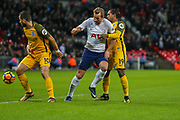Harry Kane of Tottenham Hotspur is blocked by Tomer Hemed and Jose Izquierdo of Brighton & Hove Albion during the Premier League match between Tottenham Hotspur and Brighton and Hove Albion at Wembley Stadium, London, England on 13 December 2017. Photo by Toyin Oshodi.