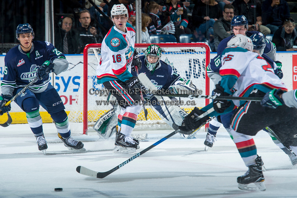 KELOWNA, CANADA - APRIL 25: Kole Lind #16 of the Kelowna Rockets looks for the pass in front of the net of Carl Stankowski #1 of the Seattle Thunderbirds on April 25, 2017 at Prospera Place in Kelowna, British Columbia, Canada.  (Photo by Marissa Baecker/Shoot the Breeze)  *** Local Caption ***