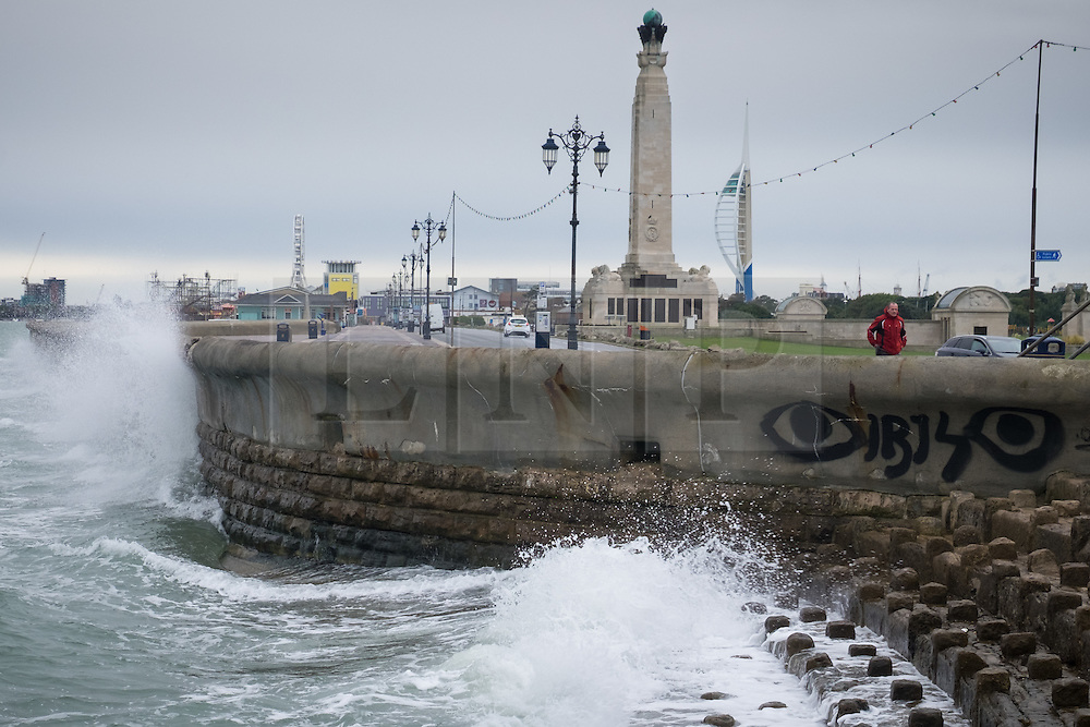 © Licensed to London News Pictures. 29/09/2016. Portsmouth, Hampshire, UK.  Waves crash against the sea wall near Southsea Common in Portsmouth. Wet and windy weather hits the south coast this morning, following days of warm sunny weather. Photo credit: Rob Arnold/LNP